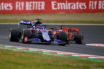 Daniil Kvyat, Toro Rosso STR14, leads Sebastian Vettel, Ferrari SF90