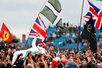 Race winner Lewis Hamilton, Mercedes AMG F1 celebrates with fans by crowd surfing