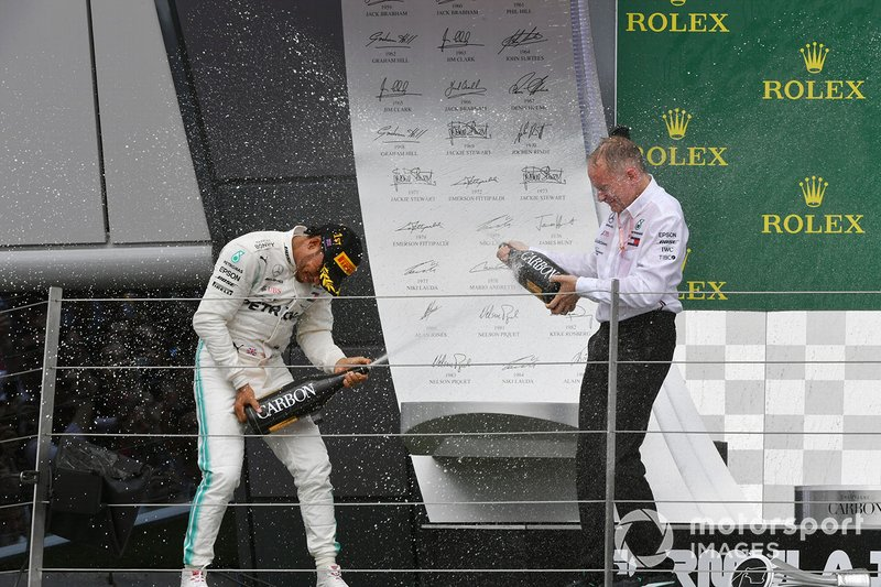 Lewis Hamilton, Mercedes AMG F1, 1st position, sprays Champagne at his team mate on the podium