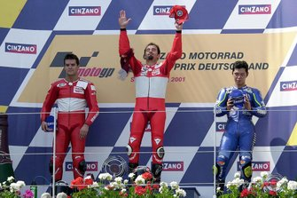 Podium: Race winner Max Biaggi, Yamaha, second place Carlos Checa, Yamaha, third place Shinya Nakano, Tech 3