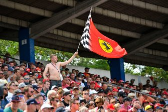 A Ferrari fan waves a flag