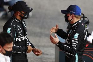 Lewis Hamilton, Mercedes-AMG F1, 1st position, and Valtteri Bottas, Mercedes-AMG F1, 2nd position, talk in Parc Ferme