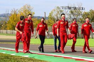 Sebastian Vettel, Ferrari, walks the track with his team
