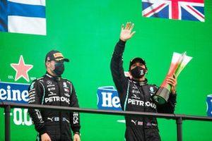 Valtteri Bottas, Mercedes-AMG F1, 2nd position, and Lewis Hamilton, Mercedes-AMG F1, 1st position, with his trophy