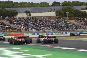 Charles Leclerc, Ferrari SF1000, battles with Kimi Raikkonen, Alfa Romeo Racing C39, at the start
