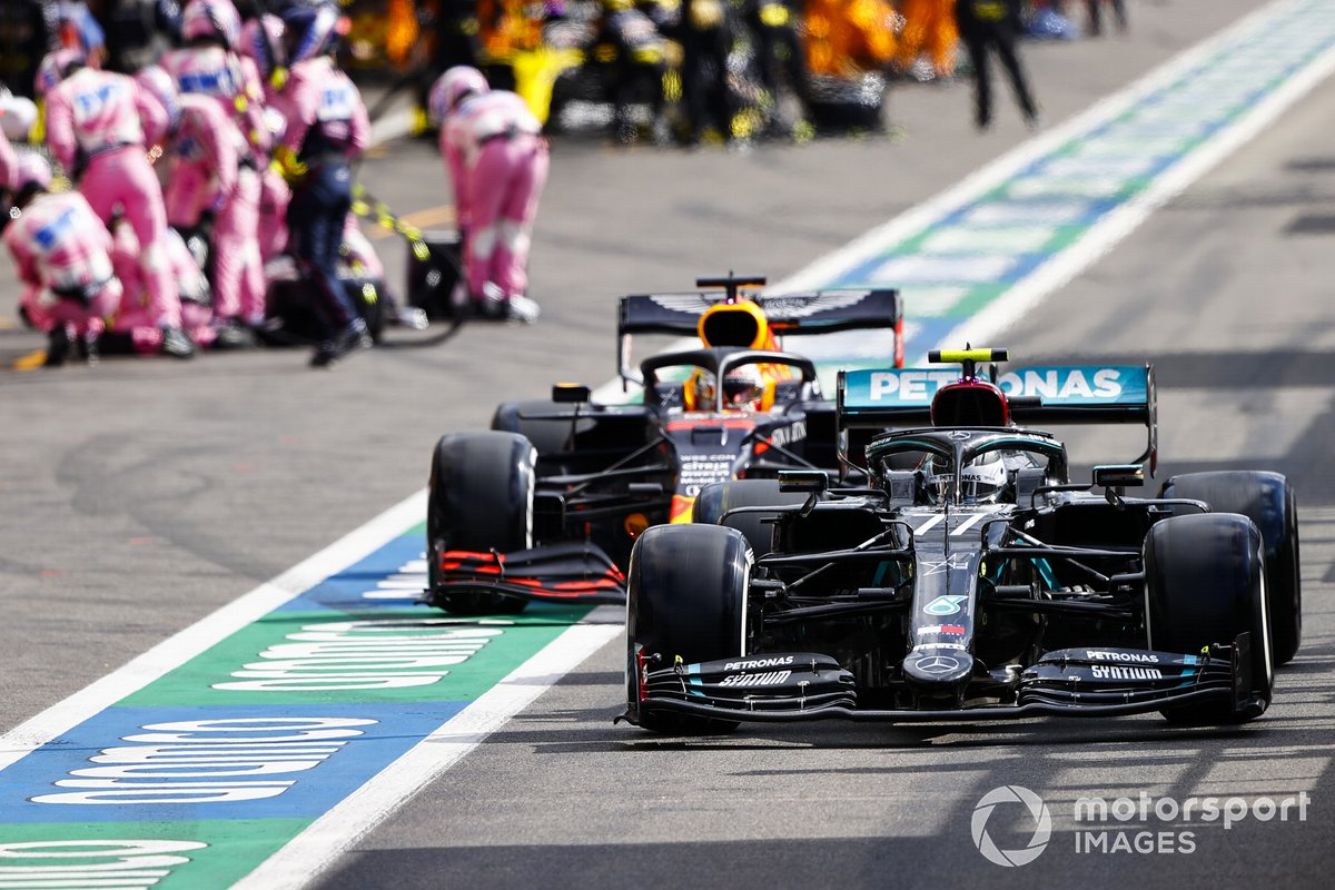 Valtteri Bottas, Mercedes F1 W11 and Max Verstappen, Red Bull Racing RB16 pit stop