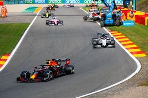 Max Verstappen, Red Bull Racing RB16, Pierre Gasly, AlphaTauri AT01, and Sergio Perez, Racing Point RP20, past the scene of the crash involving Antonio Giovinazzi, Alfa Romeo Racing C39, and George Russell, Williams FW43