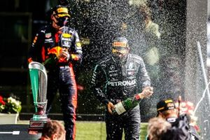 Max Verstappen, Red Bull Racing, 3rd position, Lewis Hamilton, Mercedes-AMG F1, 1st position, and Valtteri Bottas, Mercedes-AMG F1, 2nd position, spray Champagne on the podium