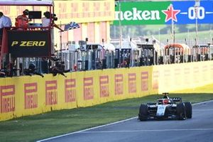 Nikita Mazepin, Hitech Grand Prix, takes the chequered flag for victory