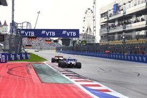 Carlos Sainz Jr., McLaren MCL35, Sergio Perez, Racing Point RP20