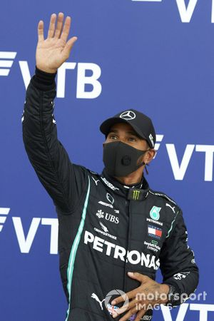 Lewis Hamilton, Mercedes-AMG F1, waves to fans after securing pole