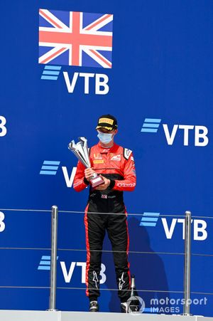 Callum Ilott, UNI-Virtuosi celebrates on the podium with the trophy