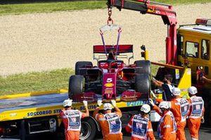 The car of Sebastian Vettel, Ferrari SF1000, is loaded onto a truck