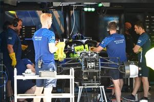 Williams team members at work on a Williams FW43B in the team's garage
