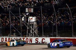 Denny Hamlin, Joe Gibbs Racing, Toyota Camry Offerpad and Kyle Larson, Hendrick Motorsports, Chevrolet Camaro HendrickCars.com on the finish line