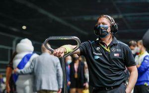 A Mercedes Benz EQ mechanic on the grid