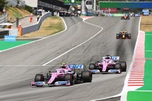 Lance Stroll, Racing Point RP20, leads Sergio Perez, Racing Point RP20, and Alex Albon, Red Bull Racing RB16