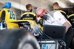 A Honda crew member works on Zach Veach, Andretti Autosport Honda
