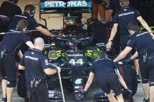 Lewis Hamilton, Mercedes F1 W11 EQ Performance, is returned to the garage