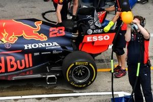 Car of Alex Albon, Red Bull Racing RB16 being pushed by Red Bull Racing Mechanic