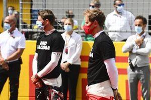 Ромен Грожан, Haas F1, и Себастьян Феттель, Ferrari, на решетке перед стартом