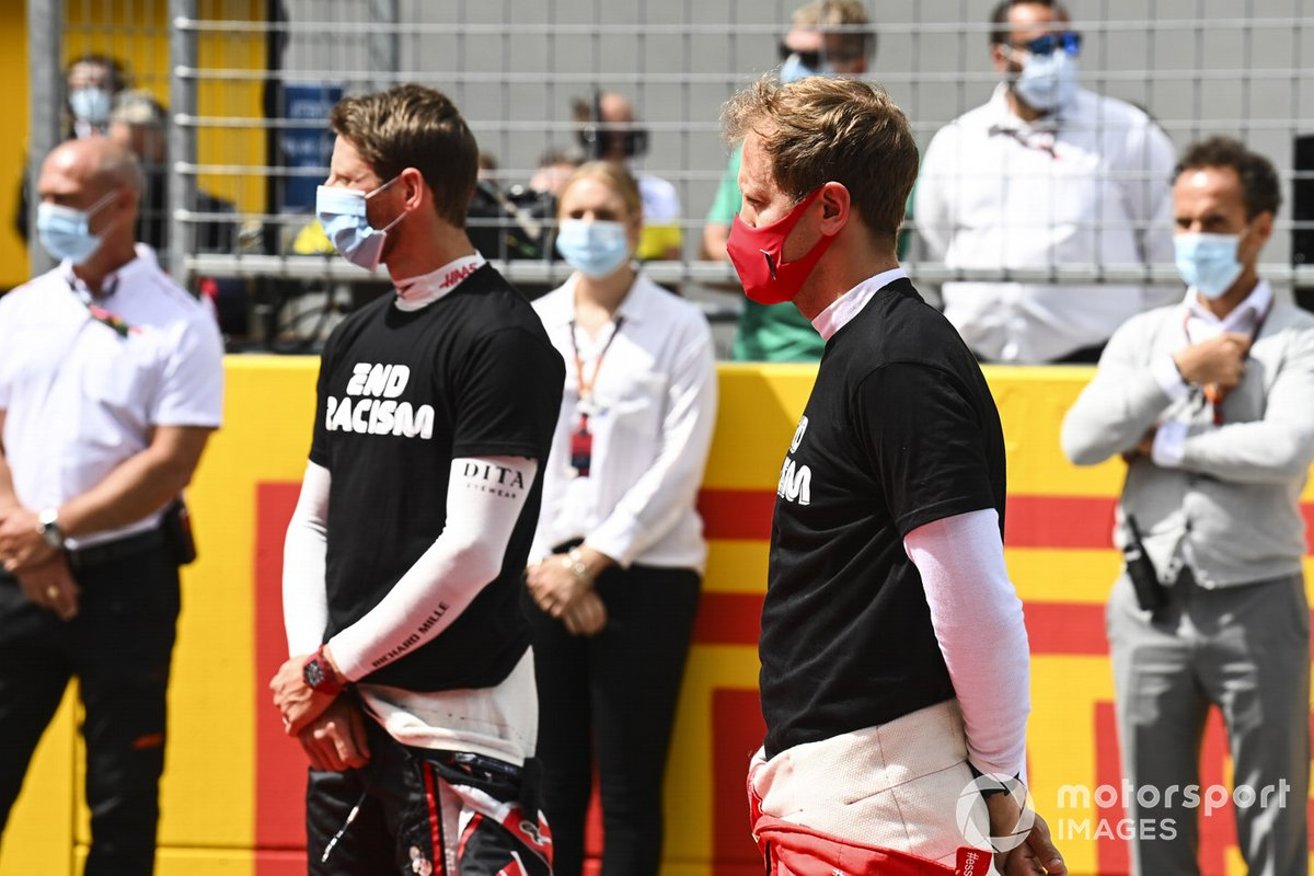 Romain Grosjean, Haas F1, and Sebastian Vettel, Ferrari, on the grid prior to the start