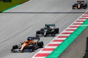 Carlos Sainz Jr., McLaren MCL35, leads Valtteri Bottas, Mercedes F1 W11 EQ Performance, and Alex Albon, Red Bull Racing RB16