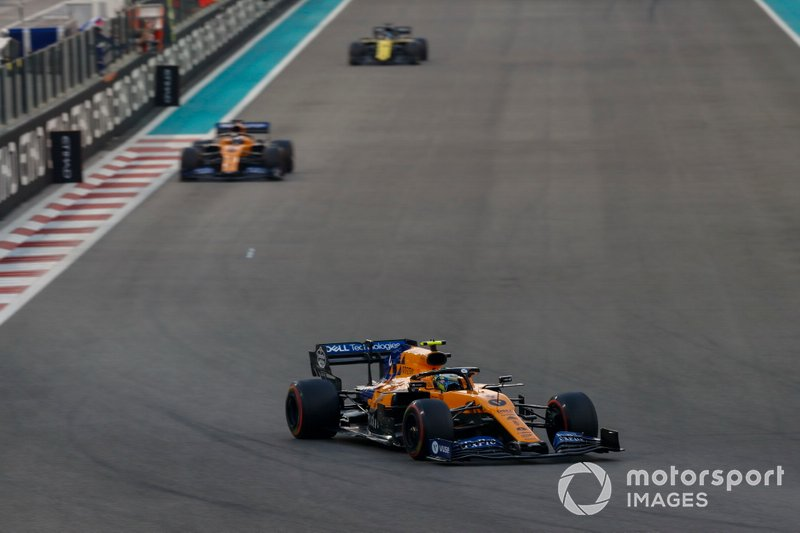 Lando Norris, McLaren MCL34, leads Carlos Sainz Jr., McLaren MCL34, and Daniel Ricciardo, Renault F1 Team R.S.19