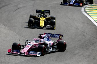 Sergio Perez, Racing Point RP19, leads Nico Hulkenberg, Renault F1 Team R.S. 19, and Daniil Kvyat, Toro Rosso STR14