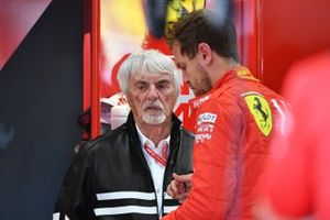 Bernie Ecclestone, Chairman Emiritus of Formula 1, in the Ferrari garage with Sebastian Vettel, Ferrari