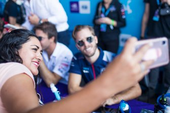 A fan takes a selfie with Sam Bird, Virgin Racing at the autograph session