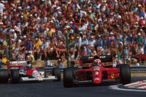 Nigel Mansell, Ferrari, Gerhard Berger, McLaren, al GP dell'Ungheria del 1990