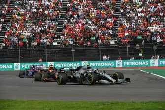 Valtteri Bottas, Mercedes AMG W10, leads Max Verstappen, Red Bull Racing RB15, and Daniil Kvyat, Toro Rosso STR14