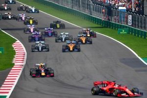 Sebastian Vettel, Ferrari SF90, leads Alex Albon, Red Bull RB15, Carlos Sainz Jr., McLaren MCL34, Lewis Hamilton, Mercedes AMG F1 W10, Lando Norris, McLaren MCL34, Valtteri Bottas, Mercedes AMG W10, and the remainder of the field at the start