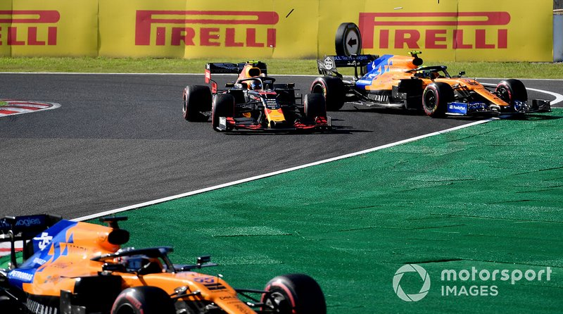 Carlos Sainz Jr., McLaren MCL34, leads Alex Albon, Red Bull RB15, and Lando Norris, McLaren MCL34