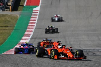 Sebastian Vettel, Ferrari SF90, leads Pierre Gasly, Toro Rosso STR14, Carlos Sainz Jr., McLaren MCL34, Kevin Magnussen, Haas F1 Team VF-19, and Kimi Raikkonen, Alfa Romeo Racing C38