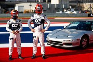 Pierre Gasly, AlphaTauri, and Yuki Tsunoda, AlphaTauri, pose with a Honda NSX