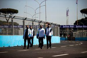 Jake Dennis, BMW I Andretti Motorsport, walks the track with team mates