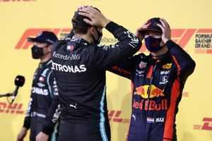 George Russell, Mercedes-AMG F1, and Max Verstappen, Red Bull Racing, talk in Parc Ferme after Qualifying