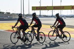 Alex Albon, Red Bull Racing walks the track on a bike