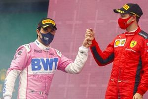 Sebastian Vettel, Ferrari, 3rd position, congratulates Sergio Perez, Racing Point, 2nd position, as he arrives on the podium