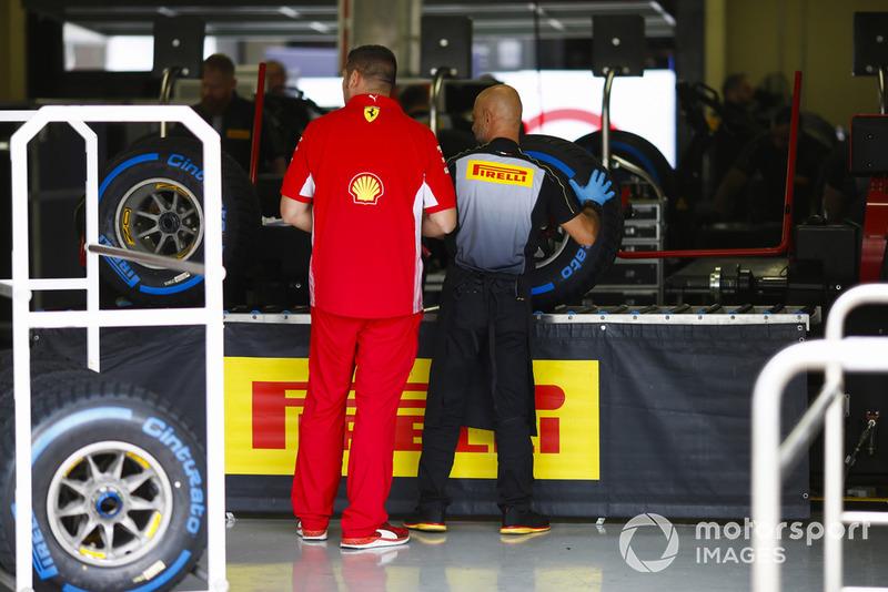 A Ferrari team member in the Pirelli sorting area