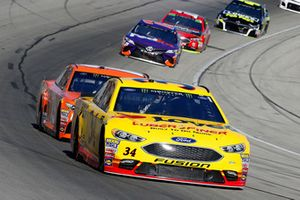 Michael McDowell, Front Row Motorsports, Ford Fusion Love's/ Luber Finer and Daniel Suarez, Joe Gibbs Racing, Toyota Camry ARRIS