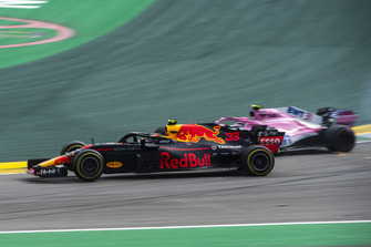 Race leader Max Verstappen, Red Bull Racing RB14 crashes whilst lapping Esteban Ocon, Racing Point Force India VJM11