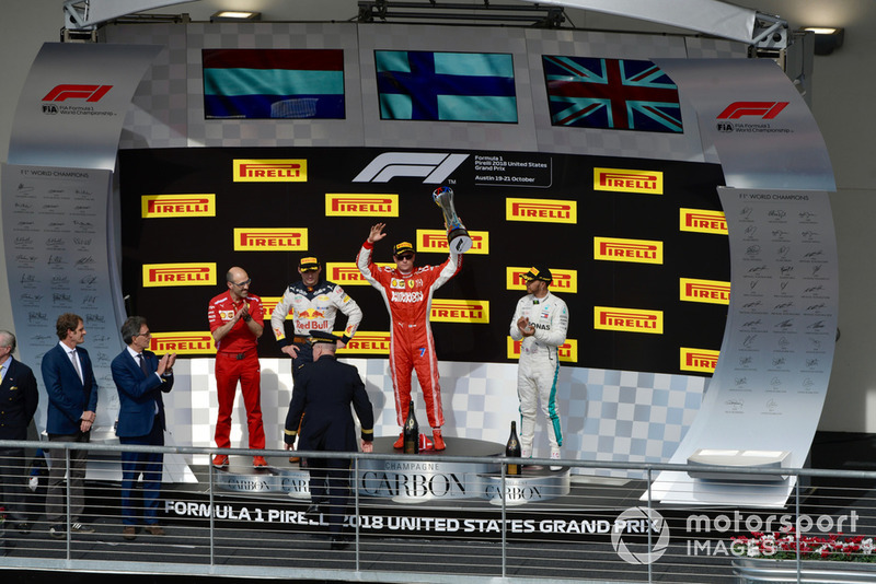 (L to R): Carlo Santi, Ferrari Race Engineer, Max Verstappen, Red Bull Racing, Kimi Raikkonen, Ferrari and Lewis Hamilton, Mercedes AMG F1 celebrate with the trophy on the podium