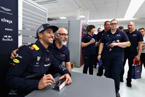 Daniel Ricciardo, Red Bull Racing poses for a photo with a Red Bull Racing team member