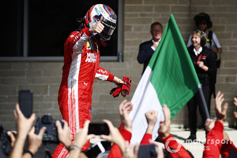 Kimi Raikkonen, Ferrari SF71H, celebrates after winning the race.