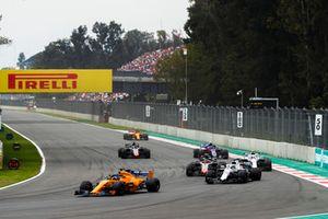 Fernando Alonso, McLaren MCL33, leads Lance Stroll, Williams FW41, Kevin Magnussen, Haas F1 Team VF-18, Sergey Sirotkin, Williams FW41, Pierre Gasly, Scuderia Toro Rosso STR13, Romain Grosjean, Haas F1 Team VF-18, and Stoffel Vandoorne, McLaren MCL33
