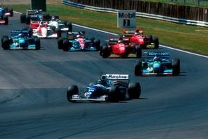Damon Hill, Williams FW16 leads Michael Schumacher, Benetton B194