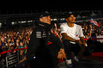 Valtteri Bottas, Mercedes AMG F1, and Lewis Hamilton, Mercedes AMG F1, on stage